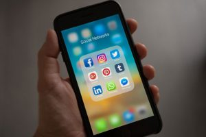Phone with social networks - 11 SEO Tips for Small Businesses